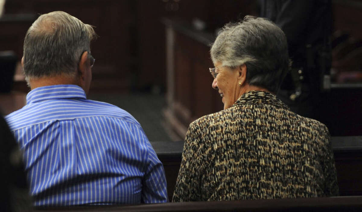 Phillip and Sandra Dunn, parents of Michael Dunn, talk as they sit in the courtroom as the jury deliberates in the trial of Michael Dunn, Saturday, Feb. 15, 2014 in Jacksonville, Fla. Dunn is charged with fatally shooting 17-year-old Jordan Davis after an argument over loud music outside a Jacksonville convenient store in 2012. Jurors are entering their fourth day of deliberations, seemingly stuck on whether to convict on some counts but not others. (AP Photo/The Florida Times-Union, Bob Mack, Pool)