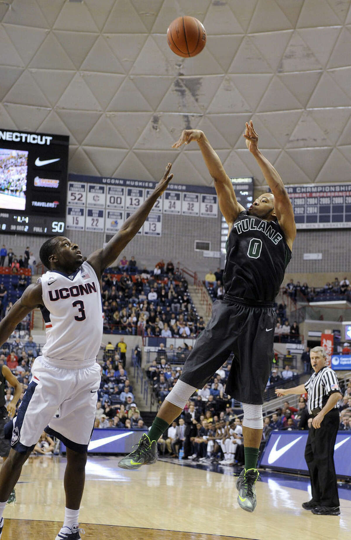 Tulane's Louis Dabney (0) shoots over Connecticut's Terrence Samuel (3) during the second half of Connecticut's 67-60 victory in an NCAA college basketball game in Storrs, Conn., on Sunday, Feb. 22, 2015. Dabney scored a game-high 19 points in his team's loss. (AP Photo/Fred Beckham)