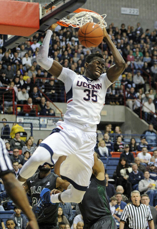 Connecticut's Amida Brimah (35) scores two of his game-high 19 points during the second half of Connecticut's 67-60 victory over Tulane in an NCAA college basketball game in Storrs, Conn., on Sunday, Feb. 22, 2015. (AP Photo/Fred Beckham)