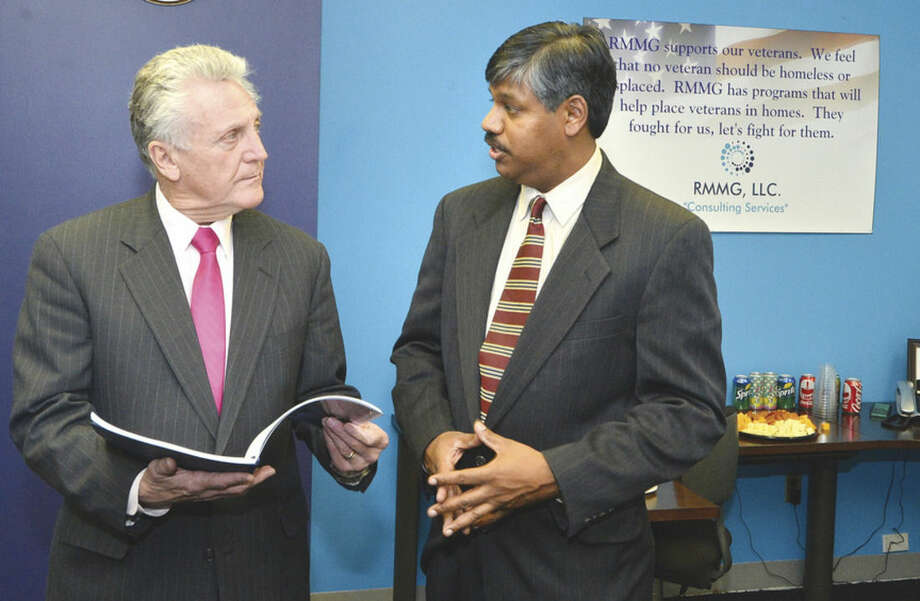 Hour Photo/Alex von Kleydorff Mayor harry Rilling talks with Residential Mortgage Modification Group President and Co-Founder Robin Ramnath