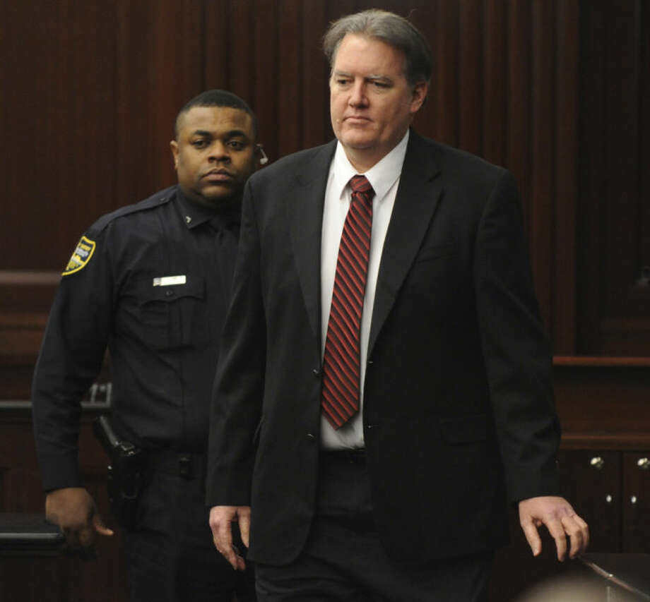 Defendant Michael Dunn is brought into the courtroom just before 5 p.m., where Judge Russell Healey announced that the jury was deadlocked on charge one and have verdicts on the other four charges as they deliberate in the trial of Dunn, Saturday Feb. 15, 2014 for the shooting death of Jordan Davis in November 2012. Dunn is charged with fatally shooting 17-year-old Davis after an argument over loud music outside a Jacksonville convenient store. (AP Photo/The Florida Times-Union, Bob Mack, Pool)