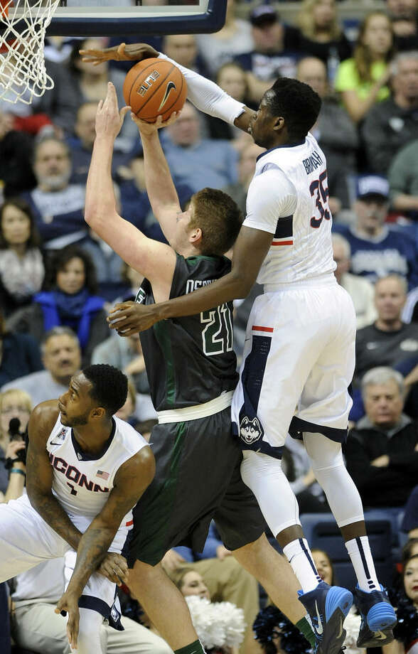 Connecticut's Amida Brimah (35) guards Tulane's Dylan Osetkowski (21) during the first half of Connecticut's 67-60 victory in an NCAA college basketball game in Storrs, Conn., on Sunday, Feb. 22, 2015. (AP Photo/Fred Beckham)