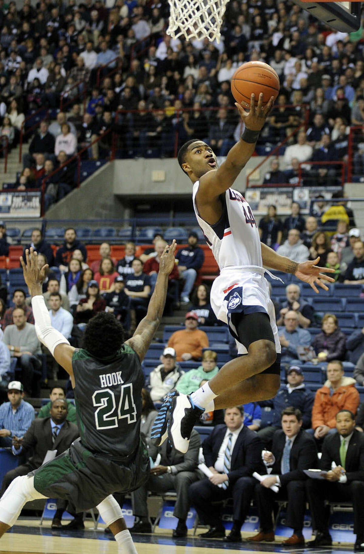 Connecticut's Rodney Purvis, right, drives past Tulane's Jay Hook (24) during the first half of an NCAA college basketball game, Sunday, Feb. 22, 2015, in Storrs, Conn. (AP Photo/Fred Beckham)