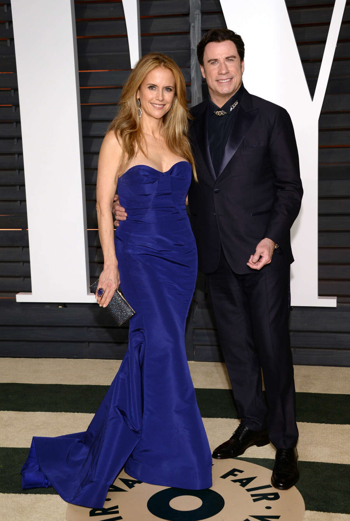 Kelly Preston, left, and John Travolta arrive at the 2015 Vanity Fair Oscar Party on Sunday, Feb. 22, 2015, in Beverly Hills, Calif. (Photo by Evan Agostini/Invision/AP)