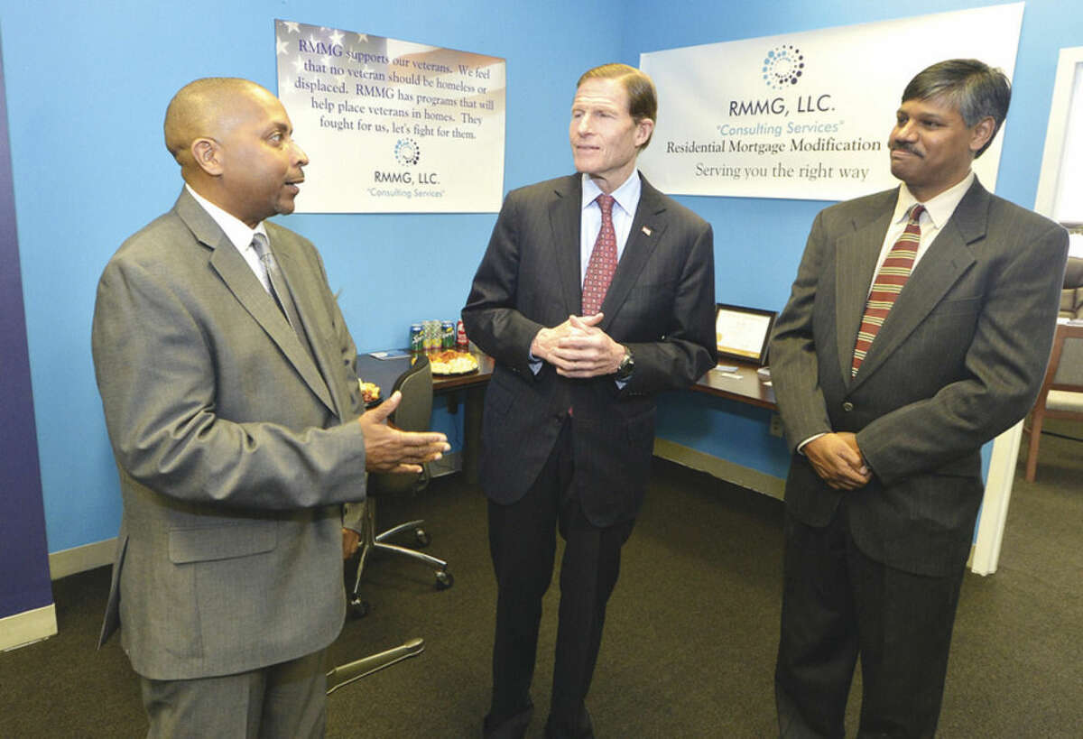 Hour photo/Alex von Kleydorff U.S. Sen. Richard Blumenthal visits Residential Mortgage Modification Group, a small Norwalk business owned by U.S. Army veteran Todd Fagan, CEO and co-founder, and Robin Ramnath, president and co-founder. RMMG helps homeowners, especially veterans, remain in their homes when facing foreclosure.
