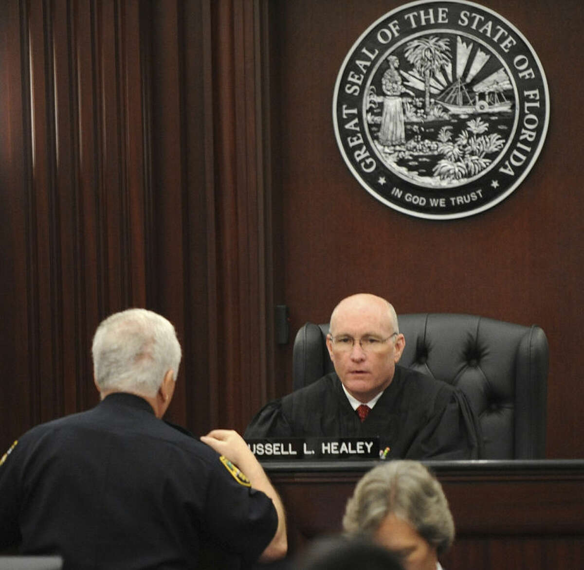 Judge Russell Healey talks with Supervisor of Courthouse Baliffs, Major Steven Weintraub, about the jury asking to have the large evidence boxes moved out of the jury room into an evidence locker to give them more room as the jury deliberates after the trial of Michael Dunn, Saturday, Feb. 15, 2014 in Jacksonville, Fla. Dunn is charged with fatally shooting 17-year-old Jordan Davis after an argument over loud music outside a Jacksonville convenient store in 2012. (AP Photo/The Florida Times-Union, Bob Mack, Pool)