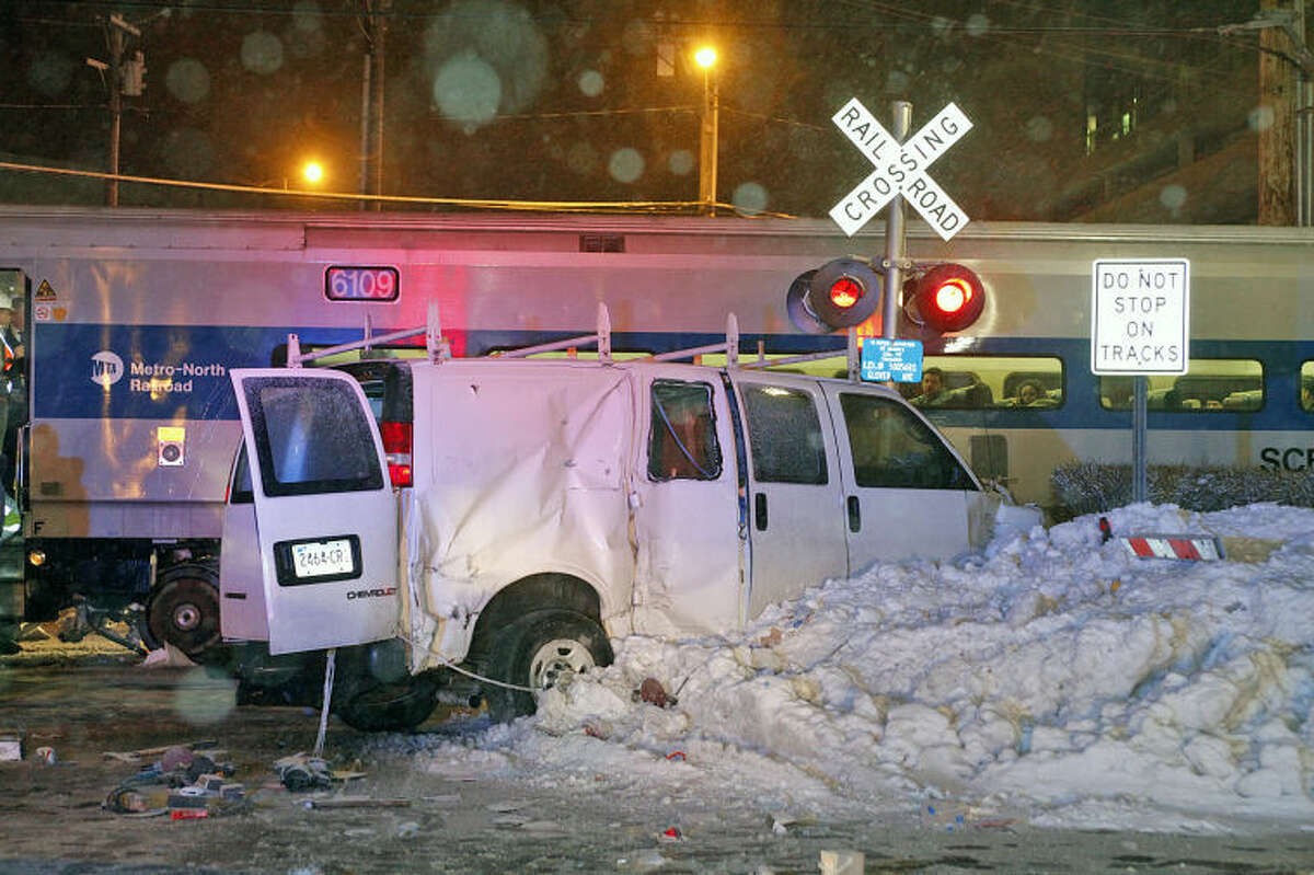 Hour Photo / Danielle Calloway The scene of the accident where an MTA train crashed with a van on Glover Avenue in Norwalk Saturday evening.