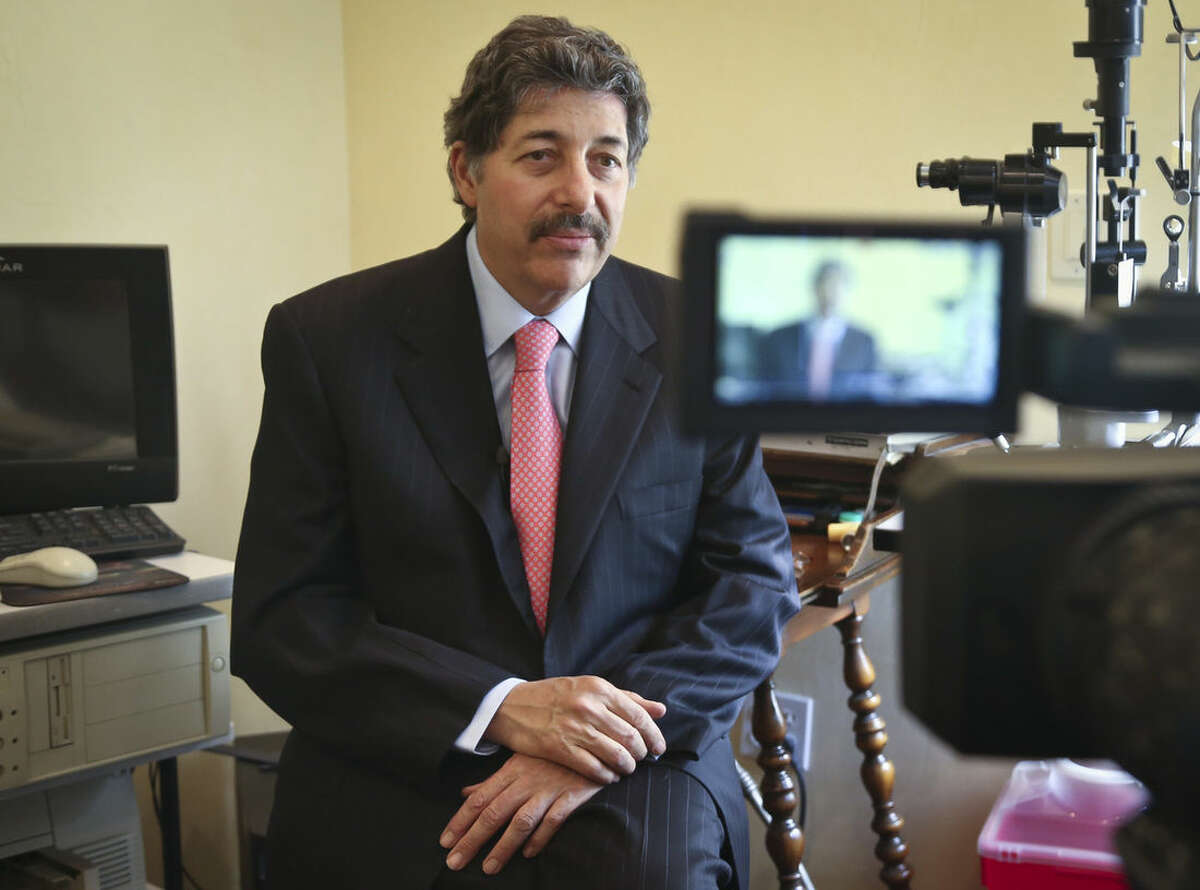 Dr. Michael T. Goldstein, New York County Medical Society President, listens during an interview on the new electronic prescribing law, Thursday, March 17, 2016, in New York. E-prescribing has surged nationwide in recent years. Every state now allows it, but only New York has a broad requirement that carries penalties. (AP Photo/Bebeto Matthews)