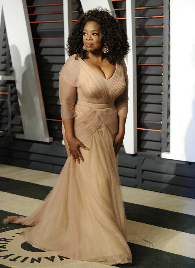 Oprah Winfrey arrives at the 2015 Vanity Fair Oscar Party on Sunday, Feb. 22, 2015, in Beverly Hills, Calif. (Photo by Evan Agostini/Invision/AP)