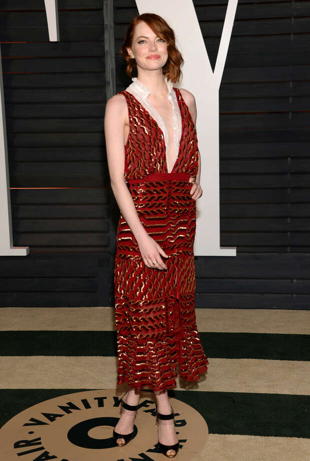 Emma Stone arrives at the 2015 Vanity Fair Oscar Party on Sunday, Feb. 22, 2015, in Beverly Hills, Calif. (Photo by Evan Agostini/Invision/AP)