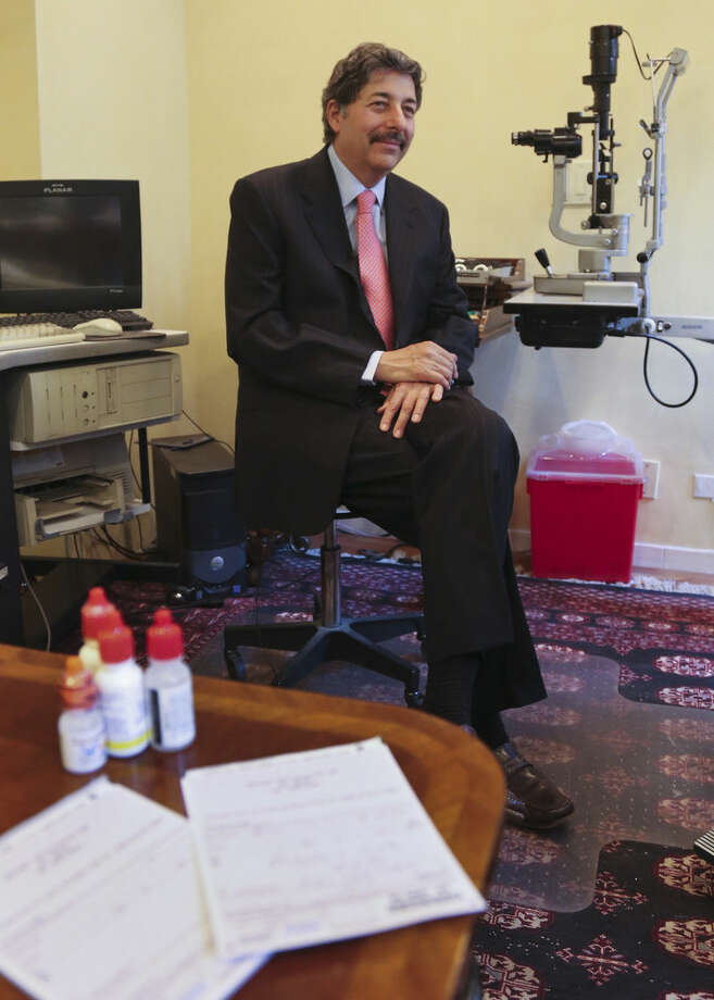 Dr. Michael T. Goldstein, New York County Medical Society President, speaks during an interview on the new electronic prescribing law, Thursday, March 17, 2016, in New York. E-prescribing has surged nationwide in recent years. Every state now allows it, but only New York has a broad requirement that carries penalties. (AP Photo/Bebeto Matthews)