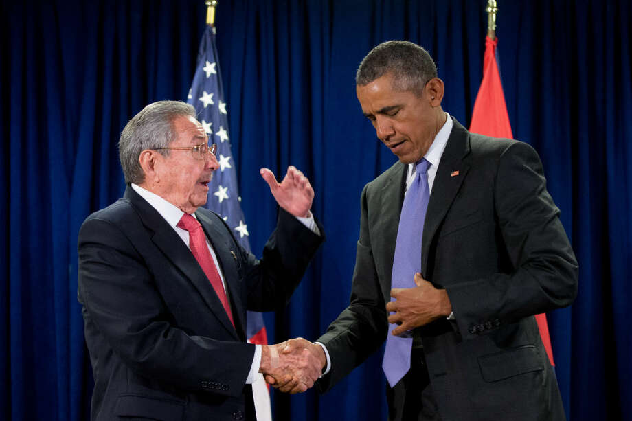FILE - In this Sept. 29, 2015, file photo, President Barack Obama shakes hands with Cuban President Raul Castro before a bilateral meeting at United Nations headquarters. Obama will open a new era in the United States' thorny relationship with Cuba during a history-making trip that has two seemingly dissonant goals: locking in his softer approach while also pushing Cuba's communist leaders to change their ways. (AP Photo/Andrew Harnik, File)