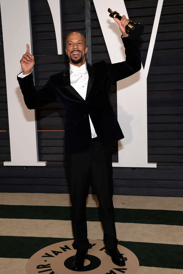 "Common, winner of the award for best original song in a feature film for ""Glory"" from ""Selma,"" arrives at the 2015 Vanity Fair Oscar Party on Sunday, Feb. 22, 2015, in Beverly Hills, Calif. (Photo by Evan Agostini/Invision/AP)"