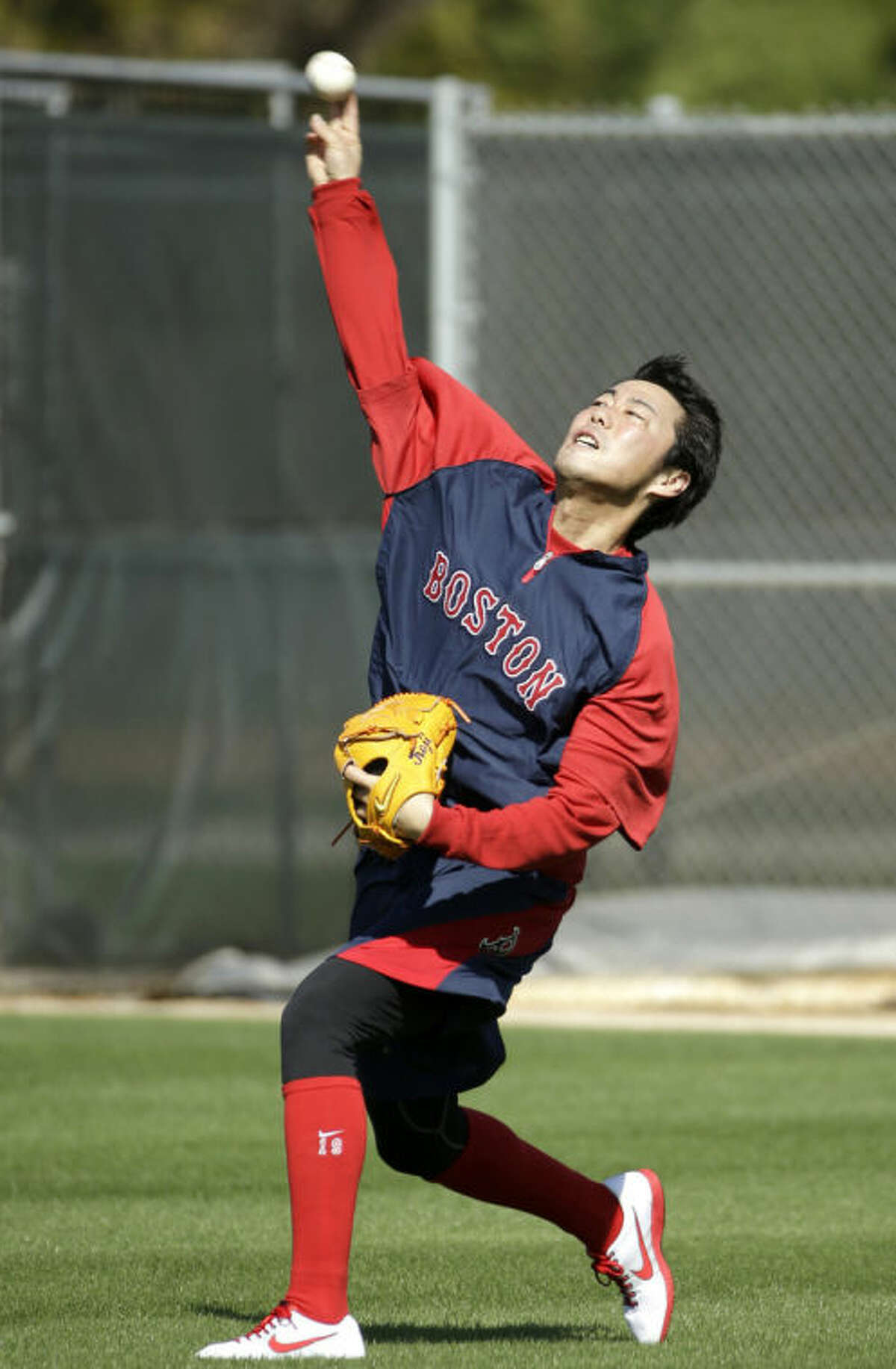 Boston Red Sox pitcher Koji Uehara throws during spring training baseball practice Saturday, Feb. 15, 2014, in Fort Myers, Fla. (AP Photo/Steven Senne)