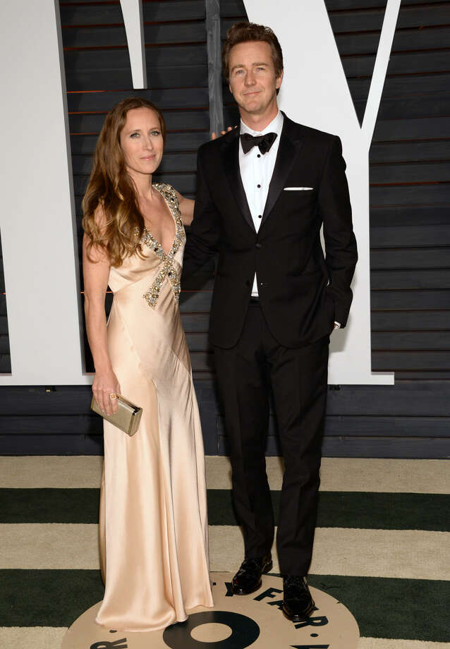 Shauna Robertson, left, and Edward Norton arrive at the 2015 Vanity Fair Oscar Party on Sunday, Feb. 22, 2015, in Beverly Hills, Calif. (Photo by Evan Agostini/Invision/AP)