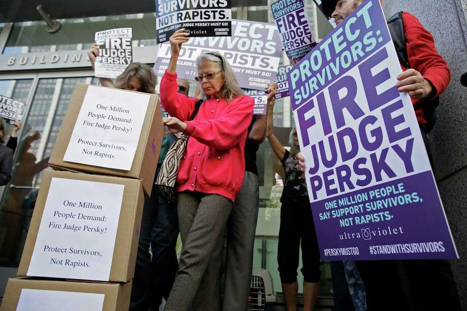 Activists from UltraViolet delivered over 1 million signatures to the California Commission on Judicial Performance calling for the removal of Judge Aaron Persky from the bench Friday., Photo: Eric Risberg, STF / Copyright 2016 The Associated Press. All rights reserved. This material may not be published, broadcast, rewritten or redistribu