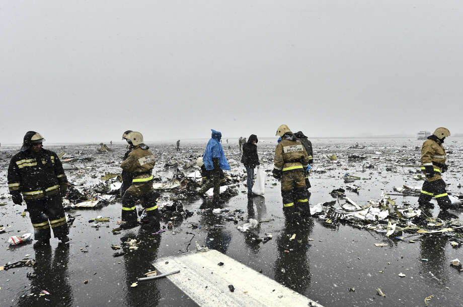 Russian Emergency Ministry employees are seen among the wreckage of a crashed plane at the Rostov-on-Don airport, about 950 kilometers (600 miles) south of Moscow, Russia Saturday, March 19, 2016. A Dubai airliner crashed and caught fire early Saturday while landing in strong winds in the southern Russian city of Rostov-on-Don, officials said. (AP Photo)
