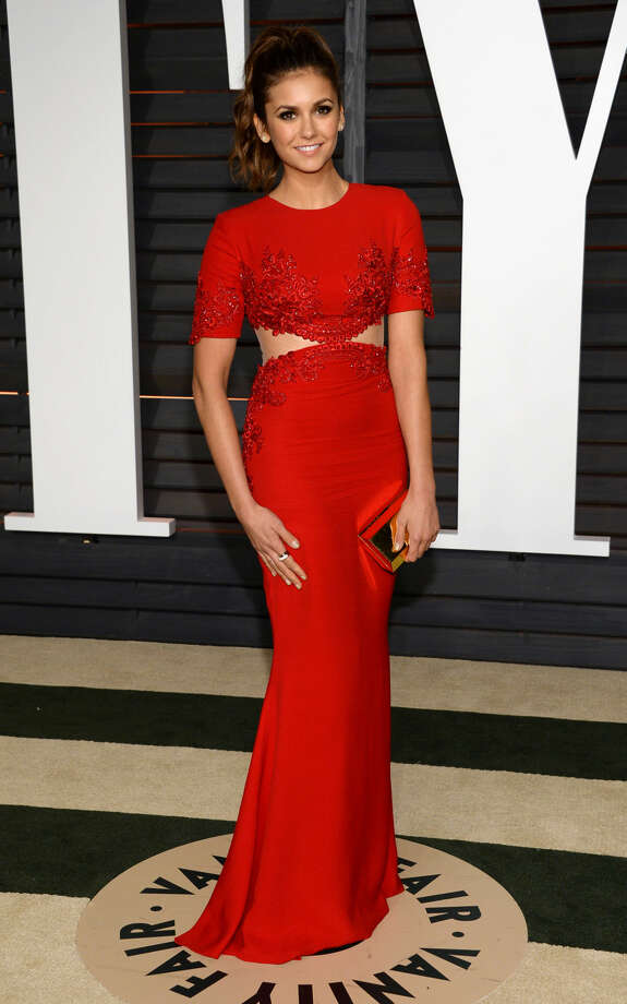 Nina Dobrev arrives at the 2015 Vanity Fair Oscar Party on Sunday, Feb. 22, 2015, in Beverly Hills, Calif. (Photo by Evan Agostini/Invision/AP)