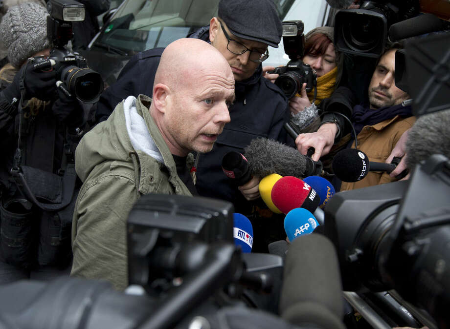 Sven Mary, lawyer for captured fugitive Salah Abdeslam, is surrounded by media as he leaves the federal police headquarters in Brussels, Belgium, Saturday, March 19, 2016. Abdeslam, the top suspect in last year's deadly Paris attacks, was arrested after a four-month manhunt with a suspected accomplice and both men have been discharged from a hospital in Brussels and will now face official questioning and a fast-track extradition effort. Abdeslam and his companion were injured when they were captured by police. (AP Photo/Peter Dejong)