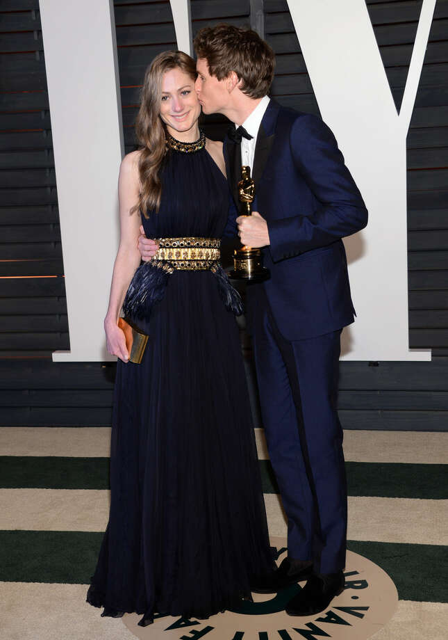 Hannah Bagshawe, left, and Eddie Redmayne arrive at the 2015 Vanity Fair Oscar Party on Sunday, Feb. 22, 2015, in Beverly Hills, Calif. (Photo by Evan Agostini/Invision/AP)