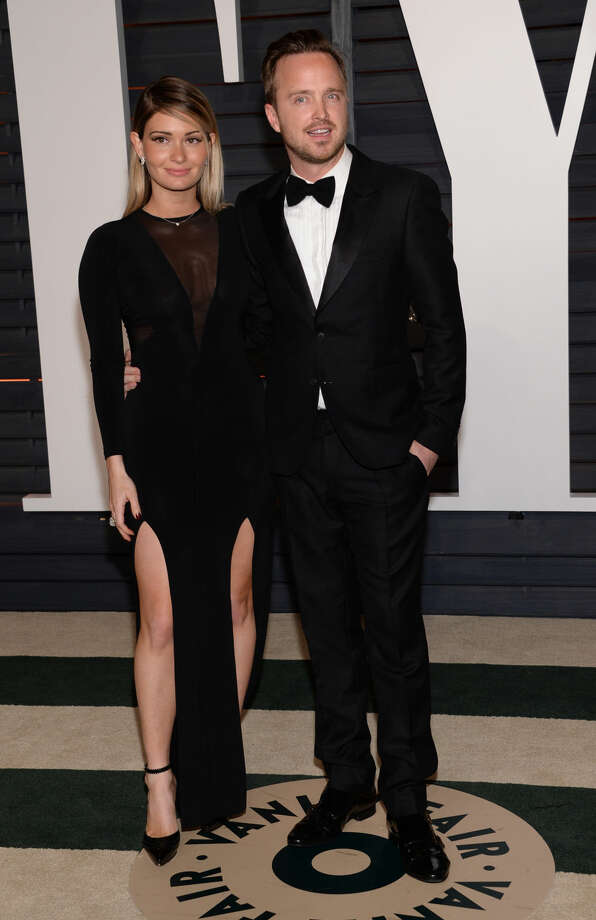 Lauren Parsekian, left, and Aaron Paul arrive at the 2015 Vanity Fair Oscar Party on Sunday, Feb. 22, 2015, in Beverly Hills, Calif. (Photo by Evan Agostini/Invision/AP)