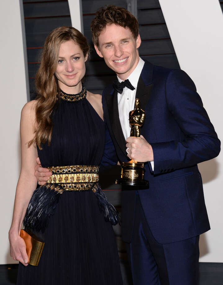 Hannah Bagshawe, left, and Eddie Redmayne arrives at the 2015 Vanity Fair Oscar Party on Sunday, Feb. 22, 2015, in Beverly Hills, Calif. (Photo by Evan Agostini/Invision/AP)