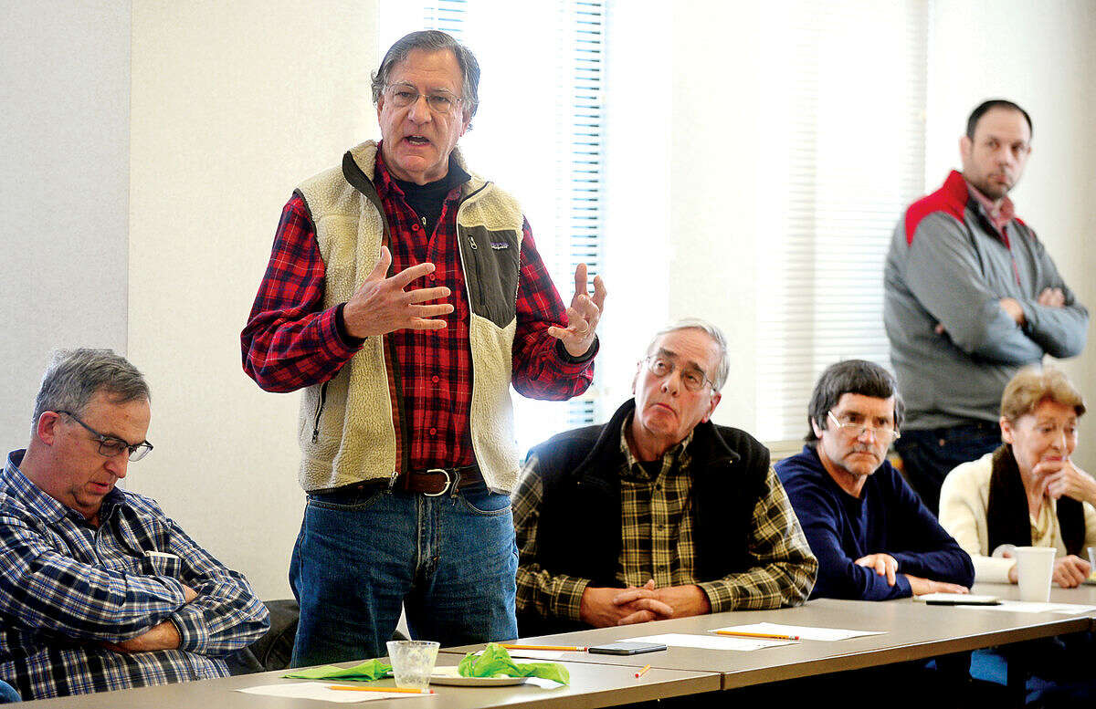 Hour photo / Erik Trautmann Norwalk resident Spike Reed poses a question as Norwalk State legislators talk about the current legislative session during The League of Women Voters of Norwalk annual Pie and Politics event Saturday, March 19, 2016 in the Norwalk Police Department Community Room.