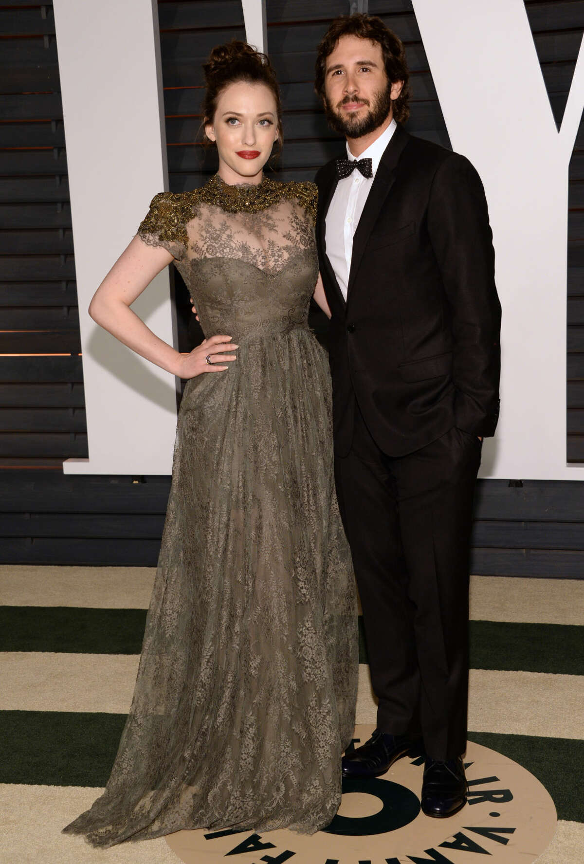 Kat Dennings, left, and Josh Groban arrive at the 2015 Vanity Fair Oscar Party on Sunday, Feb. 22, 2015, in Beverly Hills, Calif. (Photo by Evan Agostini/Invision/AP)