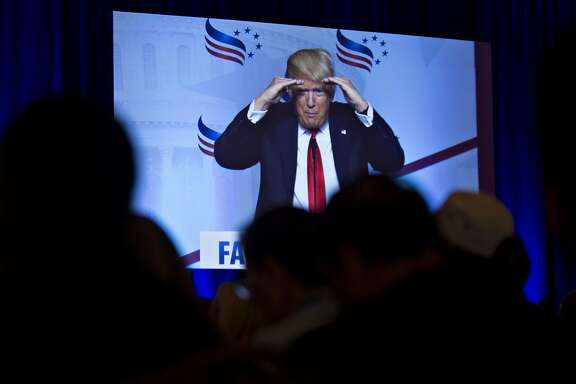 Donald Trump, president and chief executive of Trump Organization Inc. and presumptive Republican presidential nominee, is displayed on a screen as he speaks during Faith and Freedom Coalitions Road to Majority conference in Washington, D.C., U.S., on Friday, June 10, 2016. McConnell said yesterday that Donald Trump needs to pick an experienced running mate because he doesn't know a lot about the issues and strongly urged him to change course on his rhetoric. Photographer: Andrew Harrer/Bloomberg