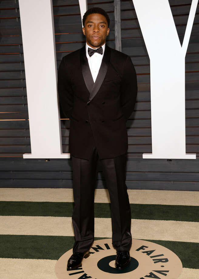 Chadwick Boseman arrives at the 2015 Vanity Fair Oscar Party on Sunday, Feb. 22, 2015, in Beverly Hills, Calif. (Photo by Evan Agostini/Invision/AP)