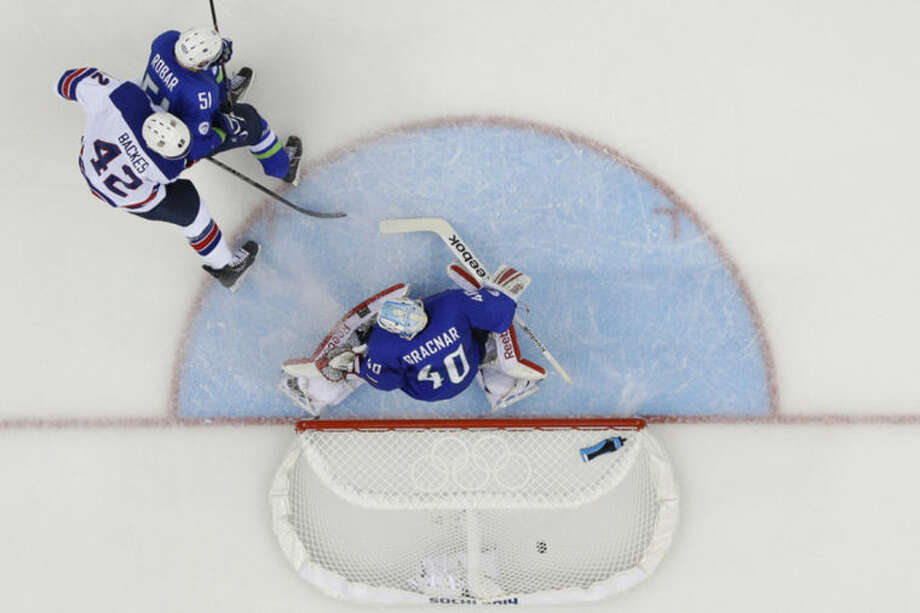 USA forward David Backes (42) watches his goal sail into the net past Slovenia goaltender Luka Gracnar (40) during the 2014 Winter Olympics men's ice hockey game at Shayba Arena Sunday, Feb. 16, 2014, in Sochi, Russia. (AP Photo/Matt Slocum)