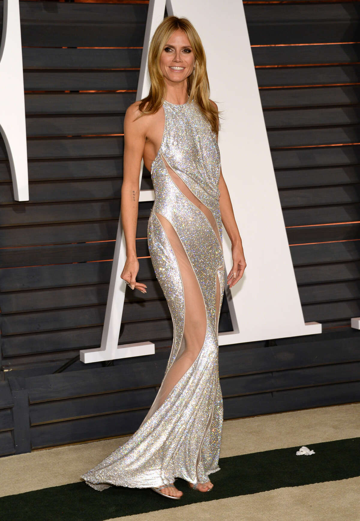 Heidi Klum arrives at the 2015 Vanity Fair Oscar Party on Sunday, Feb. 22, 2015, in Beverly Hills, Calif. (Photo by Evan Agostini/Invision/AP)