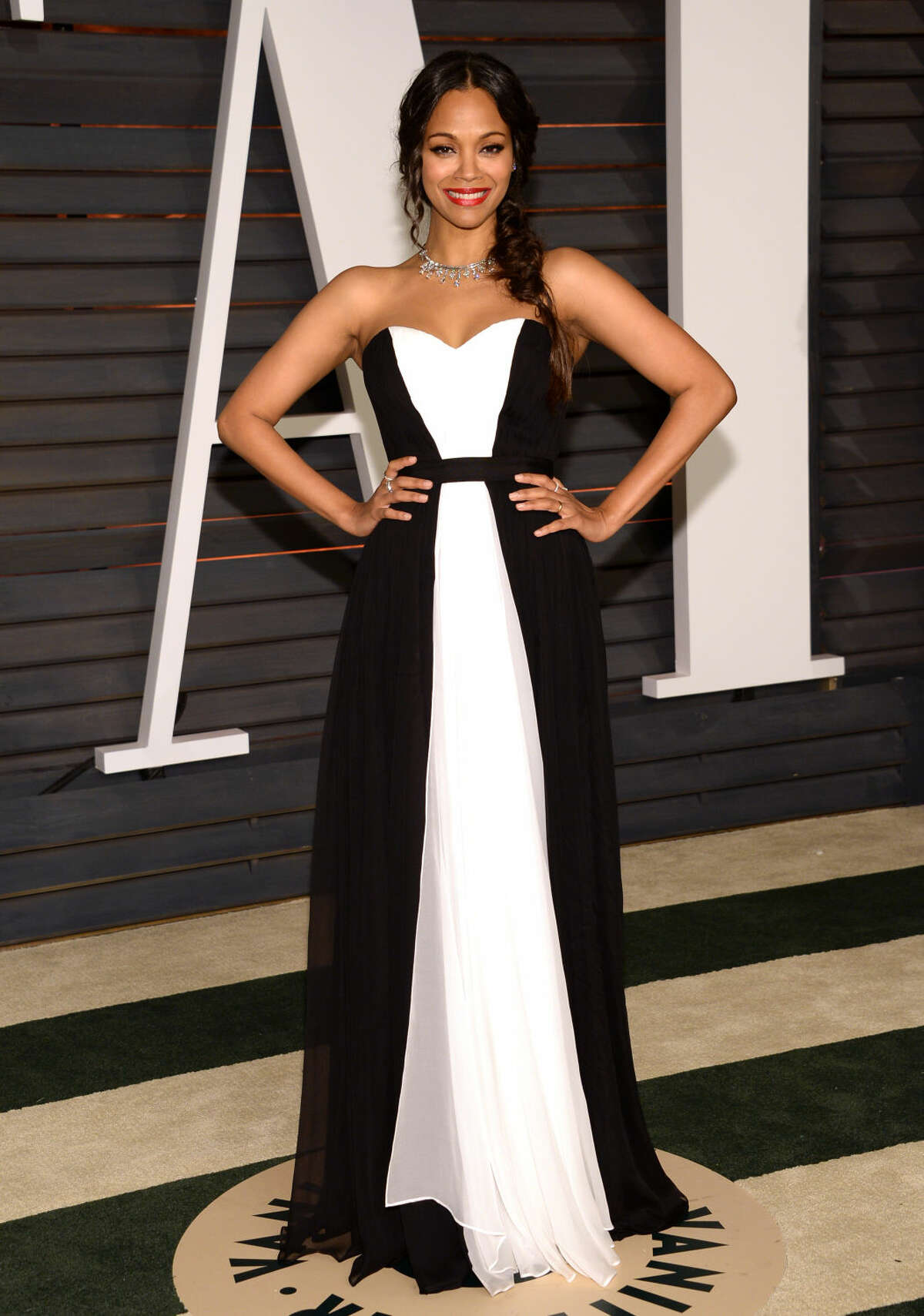 Zoe Saldana arrives at the 2015 Vanity Fair Oscar Party on Sunday, Feb. 22, 2015, in Beverly Hills, Calif. (Photo by Evan Agostini/Invision/AP)