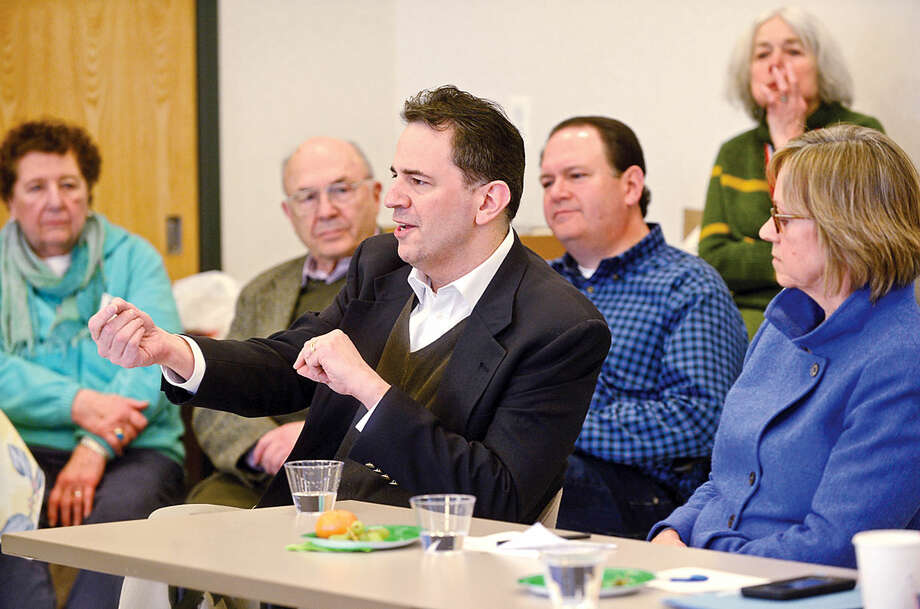 Hour photo / Erik Trautmann Norwalk State legislators including Representatives Chris Perone and Terrie Wood answer questions and talk about the current legislative session during The League of Women Voters of Norwalk annual Pie and Politics event Saturday, March 19, 2016 in the Norwalk Police Department Community Room.