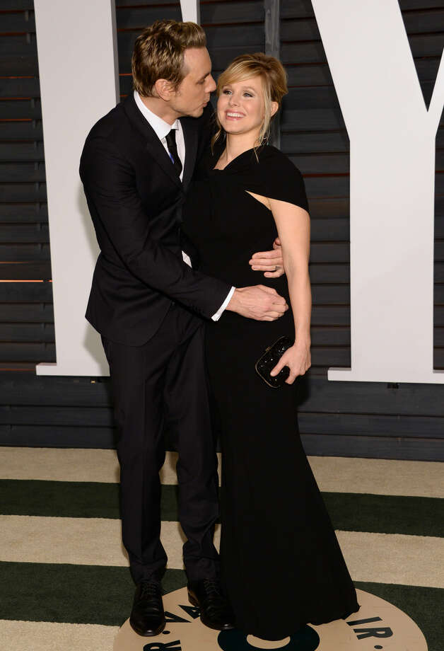 Dax Shepard, left, and Kristen Bell arrive at the 2015 Vanity Fair Oscar Party on Sunday, Feb. 22, 2015, in Beverly Hills, Calif. (Photo by Evan Agostini/Invision/AP)