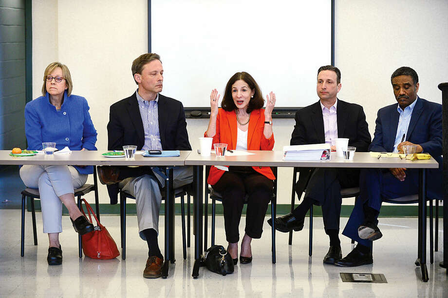 Hour photo / Erik Trautmann Norwalk State legislators including Representatives Terrie Wood, Fred Wilms, Gail Lavielle, Senator Bob Duff and Representative Bruce Morris, answer questions and talk about the current legislative session during The League of Women Voters of Norwalk annual Pie and Politics event Saturday, March 19, 2016 in the Norwalk Police Department Community Room.