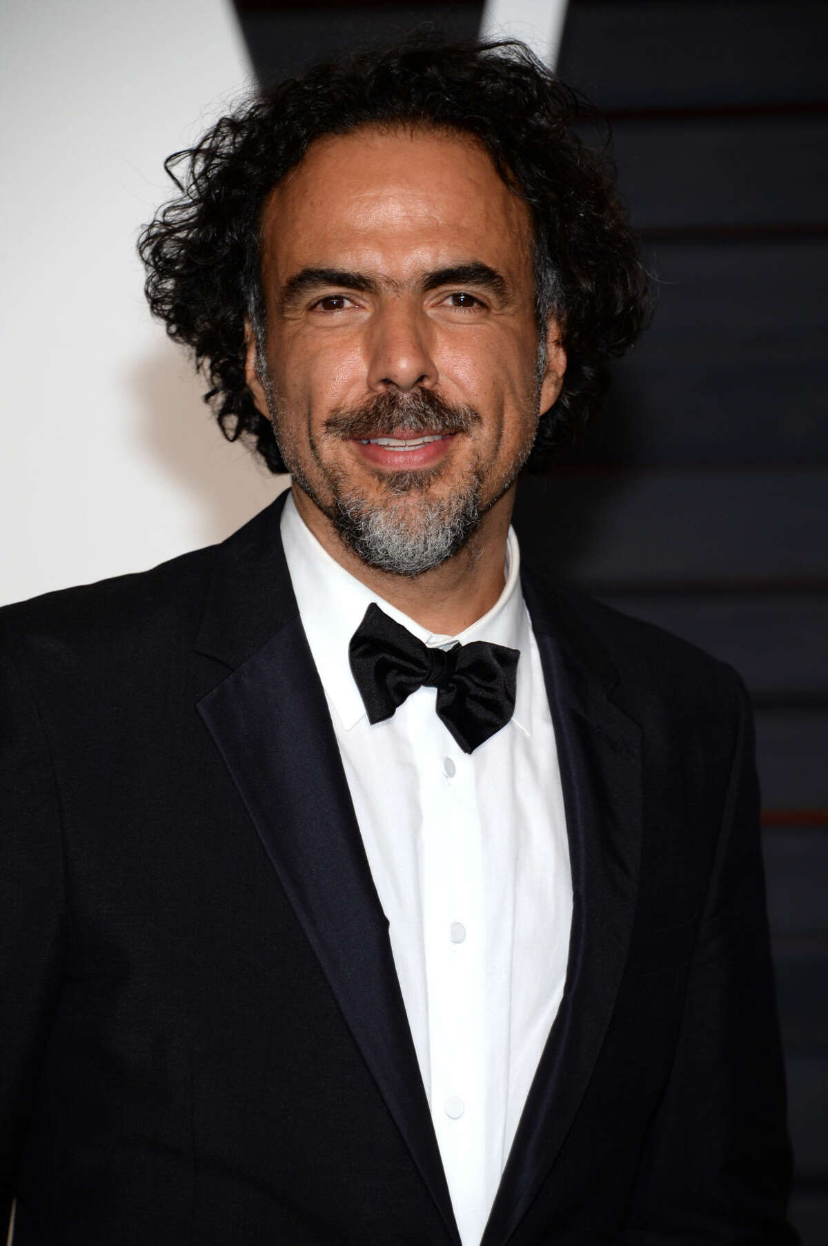 Alejandro G. Inarritu arrives at the 2015 Vanity Fair Oscar Party, early Monday, Feb. 23, 2015, in Beverly Hills, Calif. (Photo by Evan Agostini/Invision/AP)