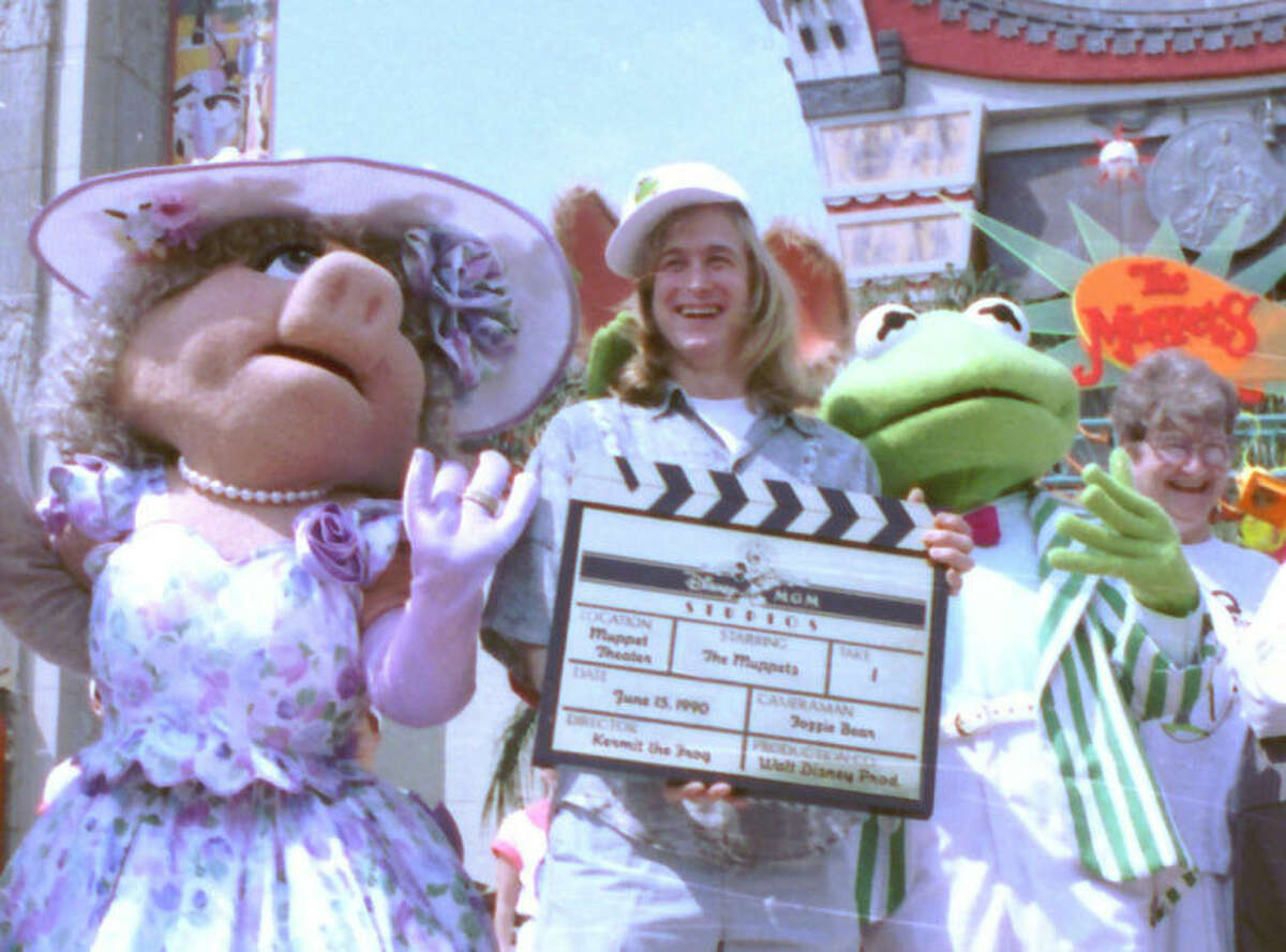 FILE - Puppeteer John Henson, the son of the late Muppets creator Jim Henson is seen with Muppets Miss Piggy and Kermit at the Disney/MGM studios in Lake Buena Vista, Florida in this June 15, 1990 file photo. Cheryl Henson says her brother died of a