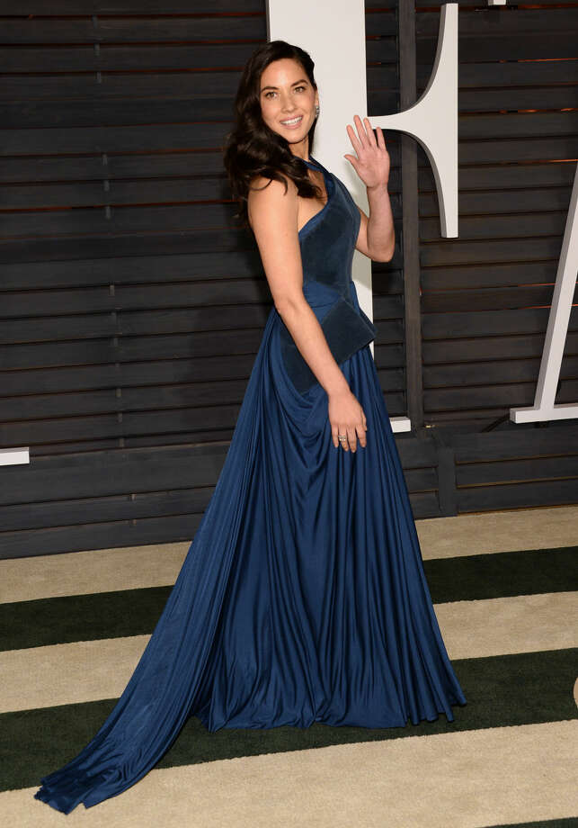 Olivia Munn arrives at the 2015 Vanity Fair Oscar Party on Sunday, Feb. 22, 2015, in Beverly Hills, Calif. (Photo by Evan Agostini/Invision/AP)