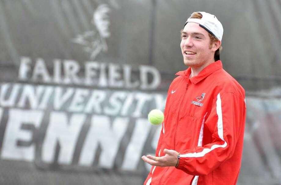Erik Kremheller warms up during tennis practice at Fairfield University on Monday, Apr. 19, 2010. Photo: Amy Mortensen / Connecticut Post