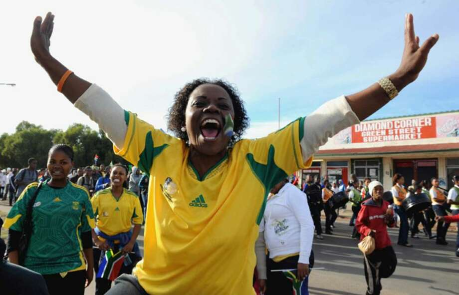 KIMBERLEY, SOUTH AFRICA - APRIL 21:  (NO SALES)  In this handout image provided by the 2010 FIFA World Cup Organising Committee South Africa, fans celebrate the 50 Day Countdown to the start of the FIFA 2010 World Cup soccer tournament on April 21, 2010 in Kimberley, South Africa.  (Photo by 2010 FIFA World Cup Organising Committee South Africa via Getty Images) Photo: Handout, Getty Images / 2010 Getty Images