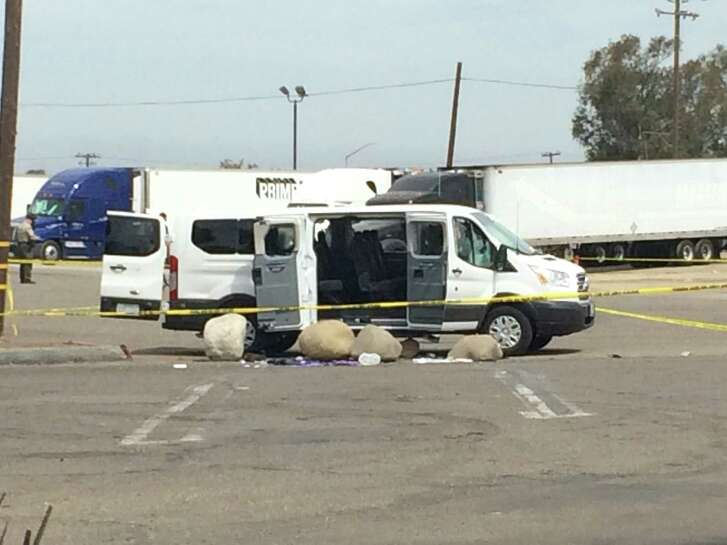 The suspect in an East Oakland slaying was holed up in this white van for several hours at Santa Barbara County truck stop before shooting himself, officials said. The boulders were there before he arrived.