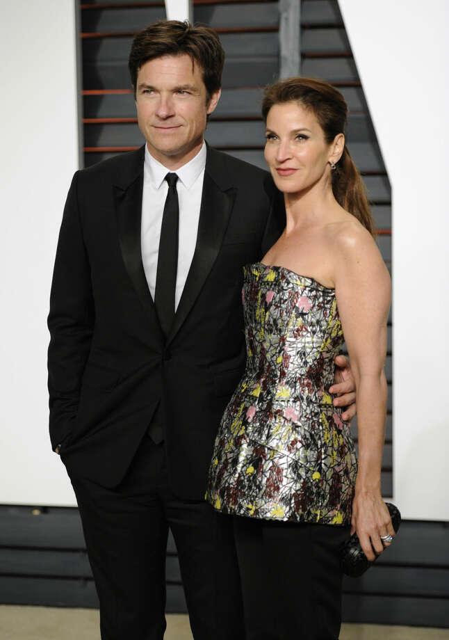 Jason Bateman, left, and Amanda Anka arrive at the 2015 Vanity Fair Oscar Party on Sunday, Feb. 22, 2015, in Beverly Hills, Calif. (Photo by Evan Agostini/Invision/AP)