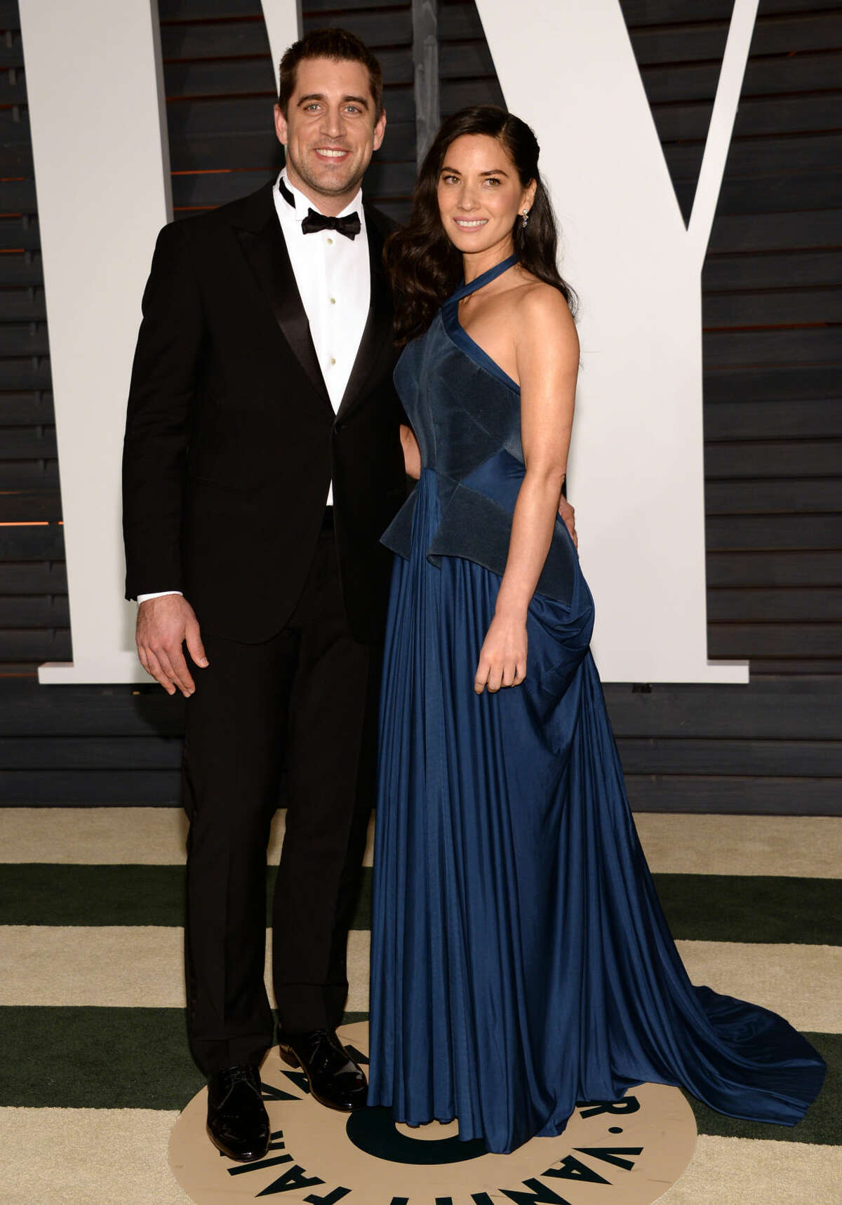 Aaron Rodgers, left, and Olivia Munn arrives at the 2015 Vanity Fair Oscar Party on Sunday, Feb. 22, 2015, in Beverly Hills, Calif. (Photo by Evan Agostini/Invision/AP)