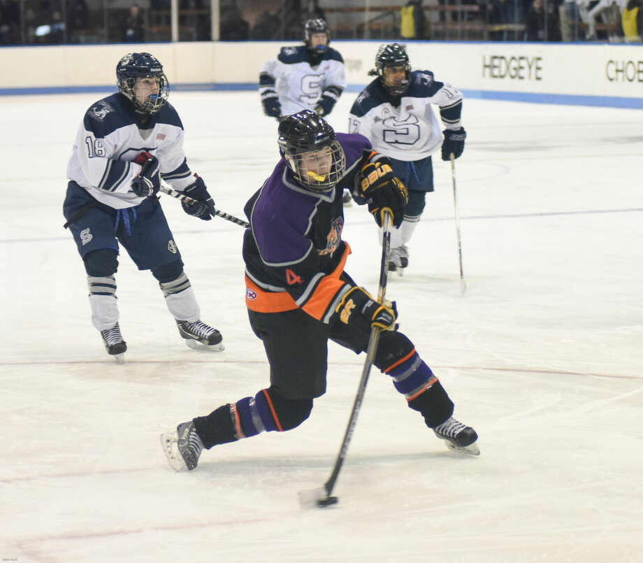 Hour photo/John Nash - The Westhill-Stamford co-op defeated Staples-Weston-Shelton by a 5-4 score on Saturday at Yale University's Ingalls Rink to win the CIAC Division 3 state championship.