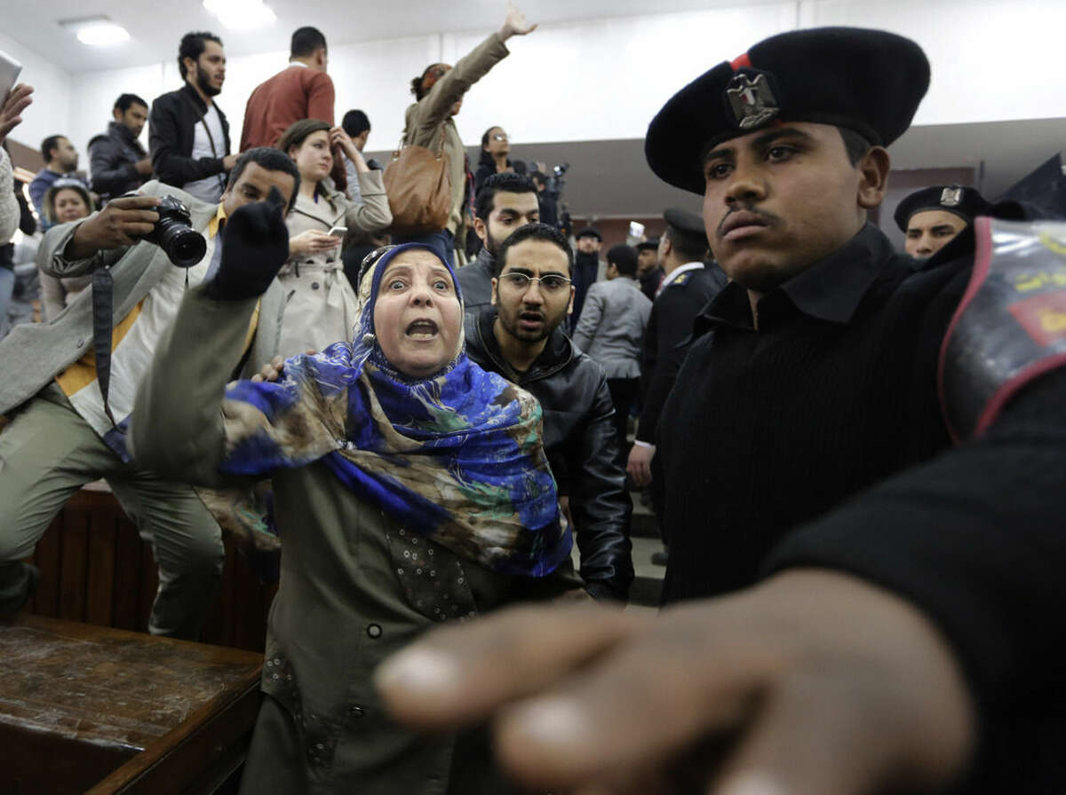 Mother of Egyptian Moustafa Yousri shouts against the court after her son was sentenced among 21 people, including prominent activists to prison terms over an unauthorized street protest in 2013, at a Cairo court, Egypt, Monday, Feb. 23, 2015. An Egyptian court sentenced Alaa Abd el-Fattah, an icon of the country's 2011 revolt to five years in prison Monday, showing authorities' determination to continue to stifle dissent despite promises by its president to release