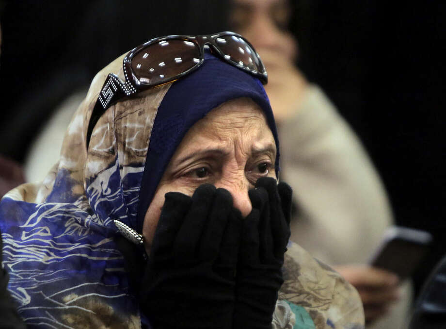 """Mother of Egyptian Moustafa Yousri grieves after her son was sentenced among 21 people, including prominent activists to prison terms over an unauthorized street protest in 2013, at a Cairo court, Egypt, Monday, Feb. 23, 2015. An Egyptian court sentenced Alaa Abd el-Fattah, an icon of the country's 2011 revolt to five years in prison Monday, showing authorities' determination to continue to stifle dissent despite promises by its president to release """"wrongly jailed youths."""" Another defendant, Ahmed Abdel Rahman, was also given five years. The others were sentenced to three years. (AP Photo/Amr Nabil)"""