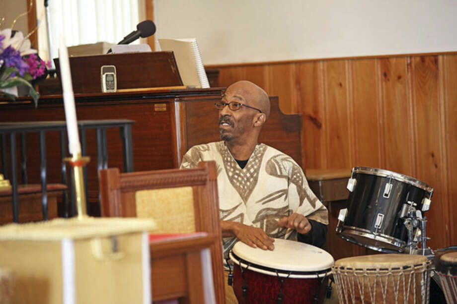 Michael Mills from Drums Not Guns plays the drums at St. James Church.