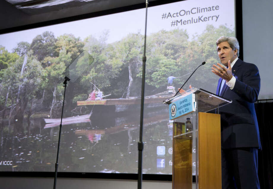 "Secretary of State John Kerry gestures during a speech on climate change on Sunday, Feb. 16, 2014, in Jakarta. Kerry called for a ""global solution"" for climate change in the first of several speeches he will deliver this year on the topic. (AP Photo/ Evan Vucci, Pool)"