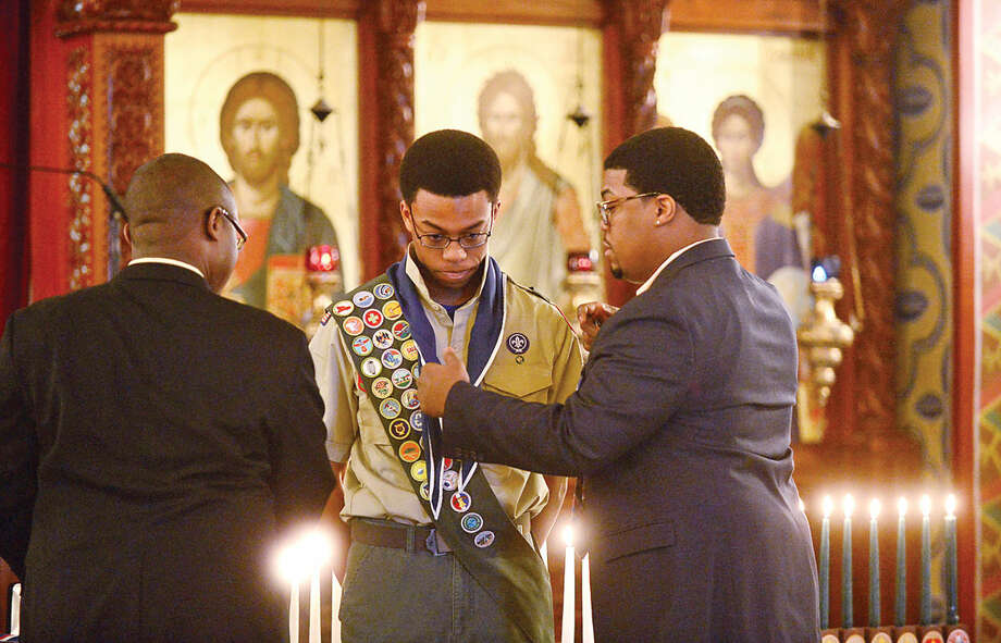 Hour photo / Erik Trautmann Sean Walters is honored during the Boy Scout Eagle Court of Honor ceremony at St. George Greek Orthodox Church where Walters was awarded the Eagle Scout Badge with the help of his family including his brothers, Colin and Greg Walters, and dignitaries Saturday afternoon.